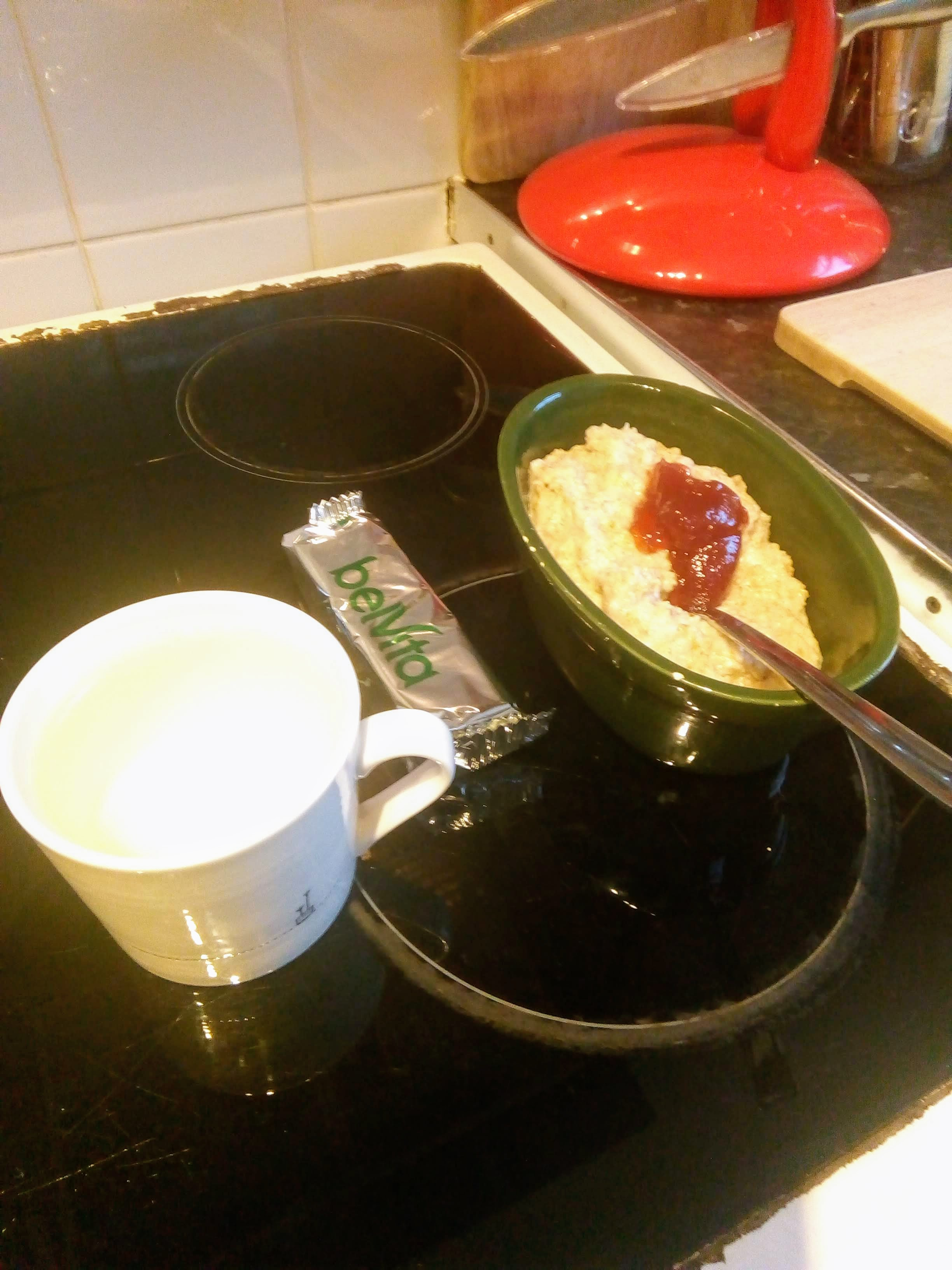 A bowl of porridge, my breakfast biscuits and a mug of water.